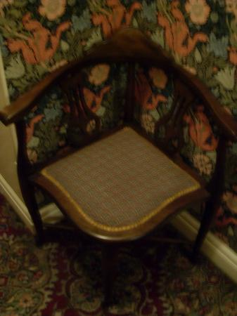 Best Western The Bell In Driffield: Old chair in a corridor - note the wallpaper!