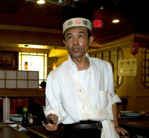 Marlow Heights, MD: chef catching a piece of shrimp in his hat