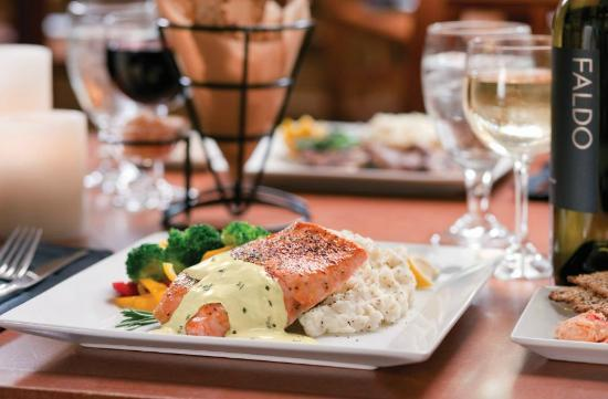The Grill at Grande Vista : Fresh Salmon Filet of the Day - served with starch and vegetable.