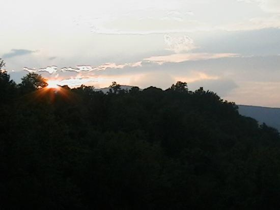 House Mountain Inn : Sun setting over mountains from front balcony.