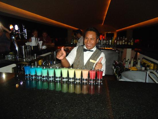 Secrets Huatulco Resort & Spa : Tito and the rainbow shot...all from the same shaker!