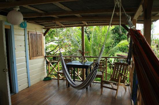 Panama's Paradise Saigoncito: Veranda with chairs and hammocks.