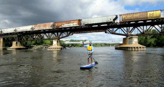 Stand Up MN Paddleboarding Day Tours: Our Minneapolis Route takes paddlers underneath trains and near Blue Heron nesting grounds!