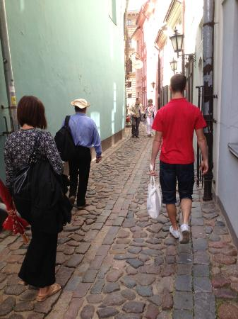 Riga Urban Adventures: One of the narrow streets with our guide and part of our group