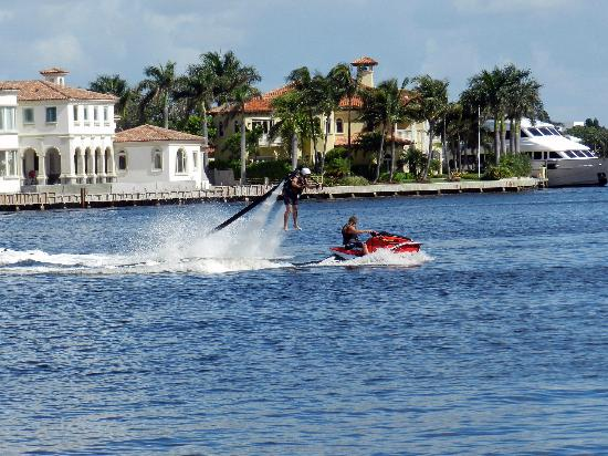 Water Taxi: Water jet pack rider.