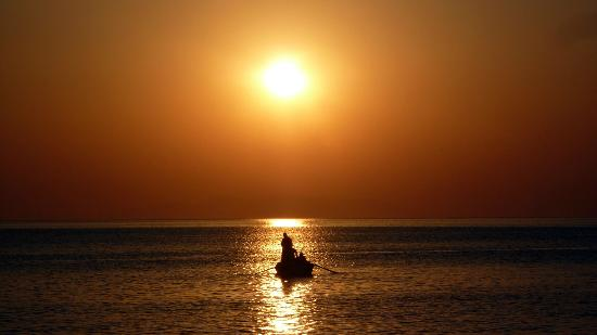 Anemoessa Studio Apartments: Fisherman at work at sunrise
