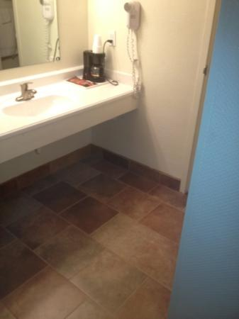 Rodeway Inn: new stone tile bathroom and vanity floors