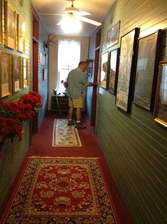 Villa Dallavalle: The hallway and my husband going into our room. Lots of historical pictures throughout the B&B.