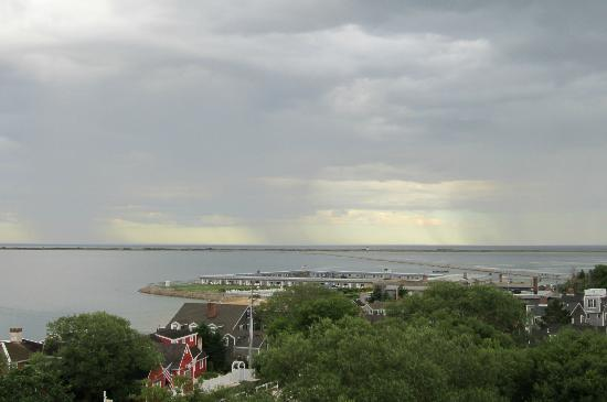 Land's End Inn: The view of distant rain showers on Cape Cod Bay