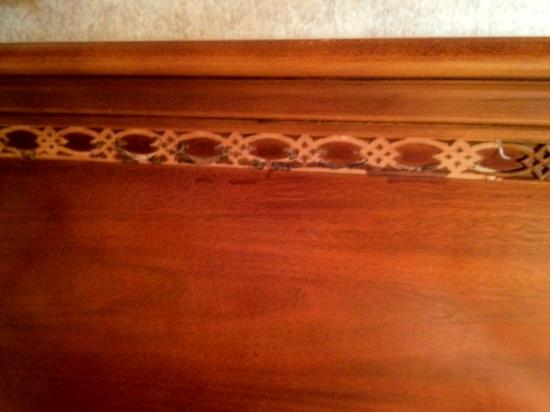 Plaza Hotel: lattice on the head board is falling off