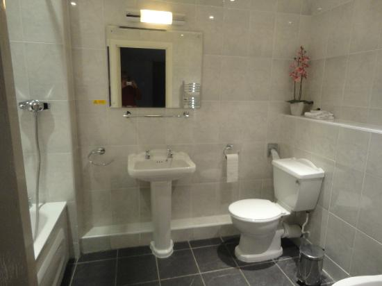 Fully tiled bathroom Picture of The Winter Dene Bournemouth