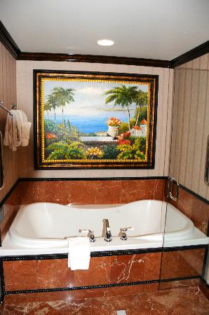 jacuzzi bathtub with painting above - picture of peppermill resort