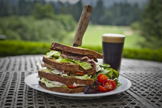 mallards cafe & pub : Foxglove on 4 slices of rye with turkey, ham, roast beef, cheddar, swiss, peppered bacon, lettuc