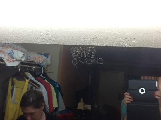 Travelodge Whittier: Gang Graffiti carved into the mirror