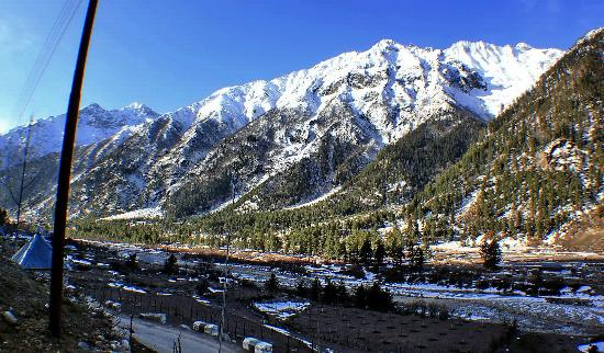 Sangla, India: Mountain range with snow-cover