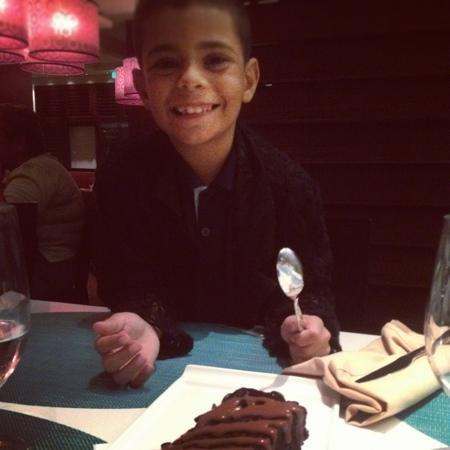 Sheraton Puerto Rico Hotel & Casino: My son.. Ready for dessert! a chocolate Godiva Cake! at Choices Restaurant, located at Main Hote