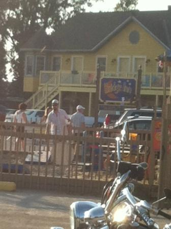 The Bridge Inn: view of the hotel from the restaurant- corn hole going on!
