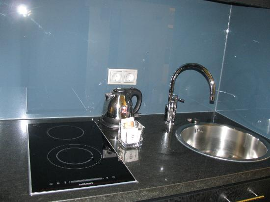 adina apartment hotel berlin hackescher markt kitchen sink and stove area