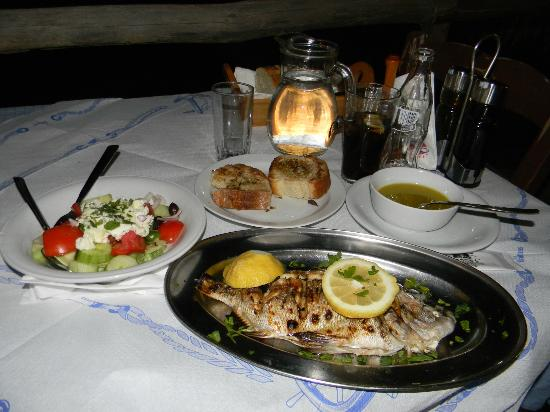 Sunset Tavern: Fresh grilled fish with an olive oil/lemon drizzle, greek salad with fresh mizithra, and local w
