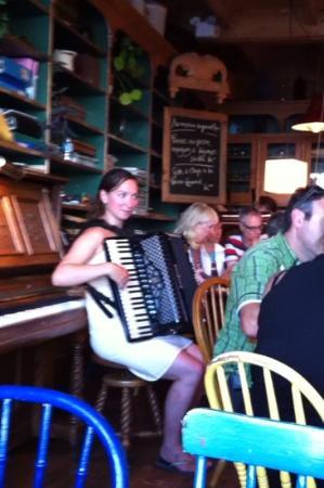 Cafe de la Grave : July 22-our hostess on the accordian