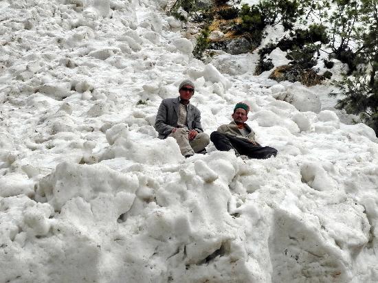 Kinnaur : Villagers on top a frozen glacier,near Chitkul