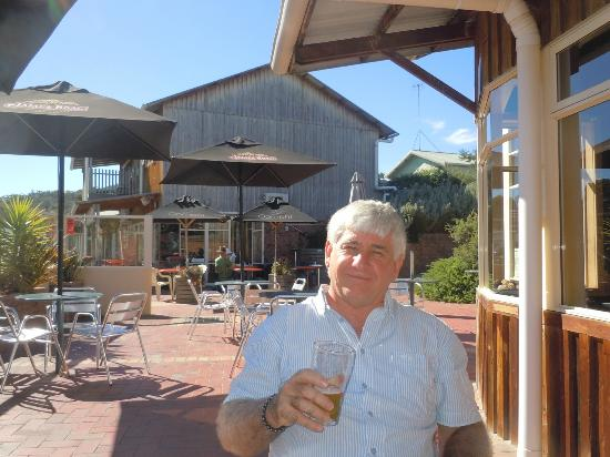 Meredith House and Mews : AW (Tony) Scott enjoying a cold beer at Coles Bay