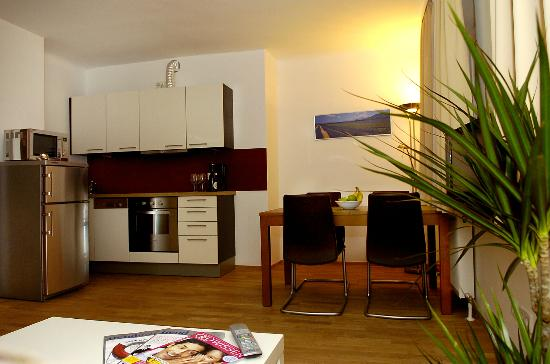 Towns Apartments: Dinning area and kitchen