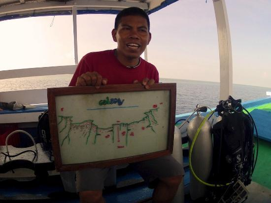 Wakatobi Dive Resort: kaz, our friendly private dive guide giving briefing before dive