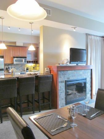 Blackstone Mountain Lodge by CLIQUE: view from dining table of fireplace and kitchen