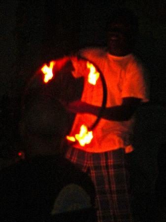 Mr. Fire about to spin a wheel of fire on his head