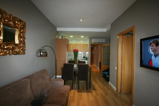 Grandom Suites: Living room towards kitchen