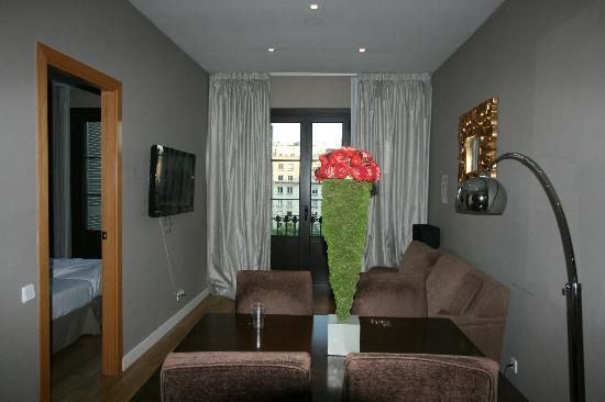 Grandom Suites: Living room towards balcony