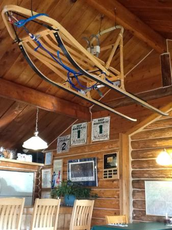 Sheep Mountain Lodge: Dog sled in the bar