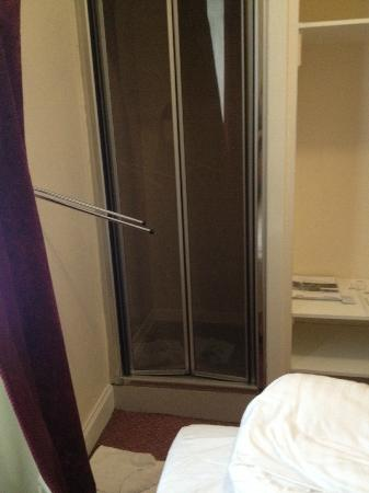 The Tarbert Hotel: There is just over 1 foot between the shower and the end of the bed.