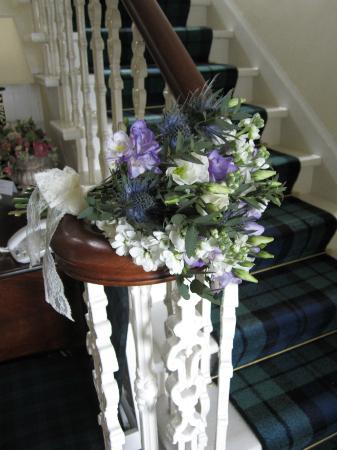 Thistle House Guest House: Erin's bouquet on the banister . . .