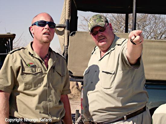 Nhongo Safaris - Day Tours: Nhongo Safaris owner and head guide checking out a cheetah sighting