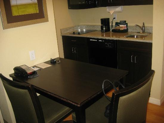 Hampton Inn & Suites Port Richey : Kitchen sink... table and chairs with a hook up for a laptop or Wifi.