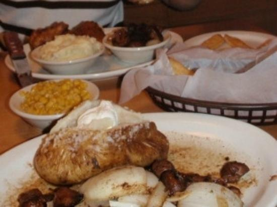 Texas Roadhouse : ft. worth ribeye steak smothered with sauteed mushroom&onions; w/ baked potato & buttered corn