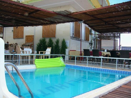 Yali Hotel: A pool, restaurant in the background