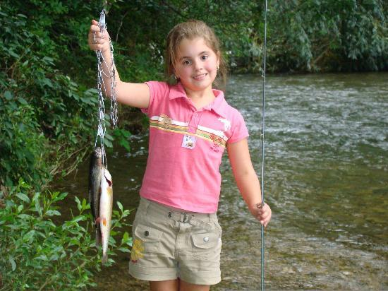 Orchard Creek Cottages: The creek is stocked with trout