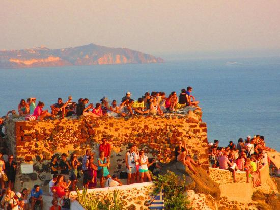 Old Oia Houses: Oia Castle. Look at the crowd that gathered here to watch sunset