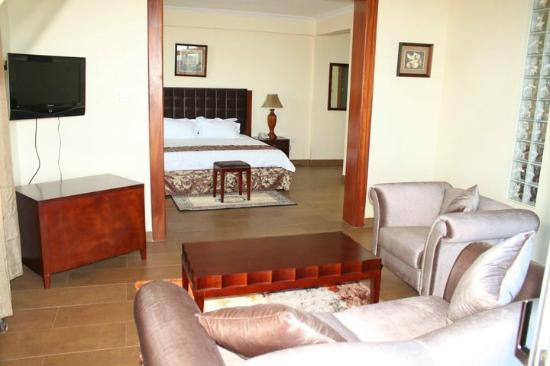 Silver Palm Hotel : En-suite sitting room with Bedroom view