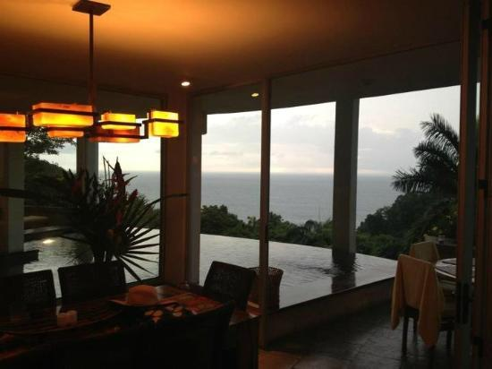 Tulemar Bungalows & Villas: View from house at dusk - Cas Las Nubes