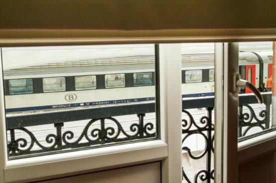 L'Appart-Hotel Simi : view from main room in apartment of trains across the small road