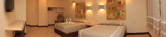 Hotel Plaza Tangolunda: vista de una de las habitaciones arreglada