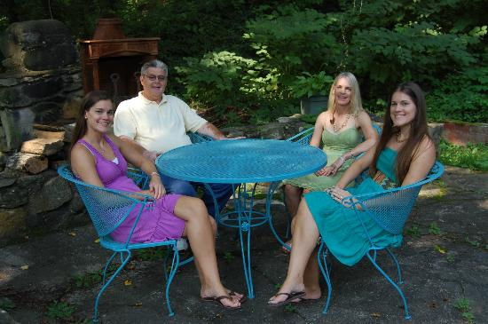 The Pines Cottages: Our family sitting on the back porch of cottage 15