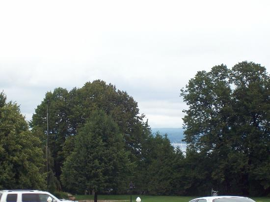 AmericInn Petoskey: Tiny view of lake through trees