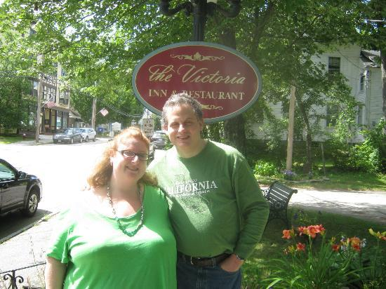 The Victoria Inn: my husband, and I, in front of the Inn, by one of the signs