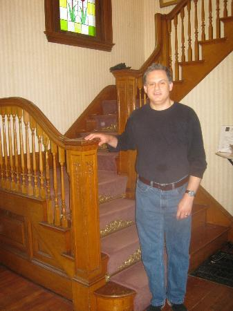 The Victoria Inn: my husband at bottom of wooden staircase