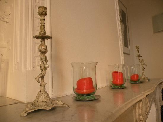 Maison Dauphine : Vanilla-scented candles on the fireplace